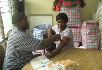 A health care professional from Planned Parenthood Association of Ghana providing screenings for interested producers in Cape Coast
