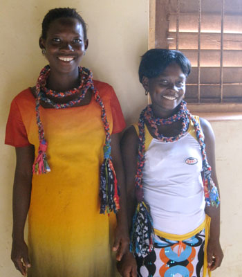 Two Ajumako producers modeling their braided necklace samples
