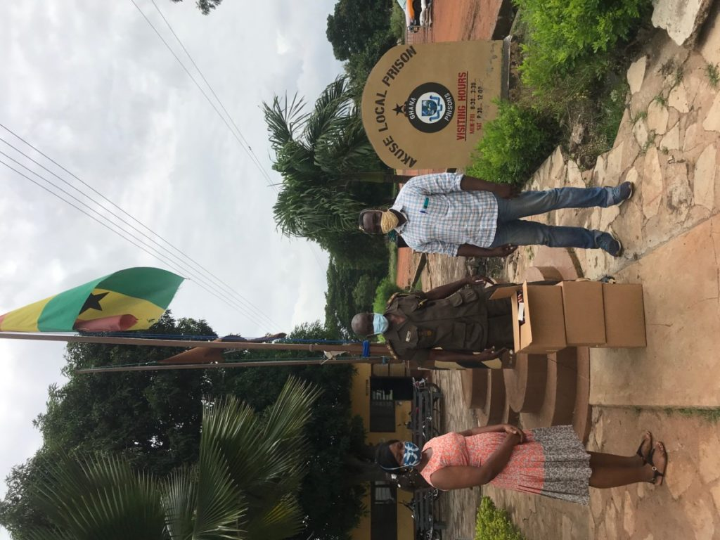 Elizabeth Adams and Amos Kporshiebu delivering boxes of face masks to Akuse Local Prison.